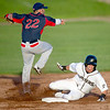 Blasters outfielder KC Huth tries to break up a double play as Lincoln infielder Tyler Urps watches the out at first base during Joplin's game against the Saltdogs on Thursday night at Joe Becker Stadium.<br /> Globe | Laurie Sisk