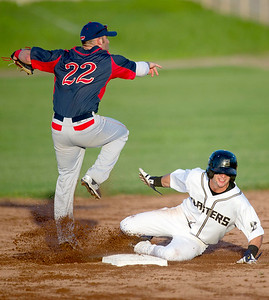 Blasters outfielder KC Huth tries to break up a double play as Lincoln infielder Tyler Urps watches the out at first base during Joplin's game against the Saltdogs on Thursday night at Joe Becker Stadium. Globe   Laurie Sisk