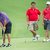 Alex Kanakis, of Kansas City, Mo., putts on the no. 2 green as Nick Yuhas, center, of Joplin and defending champ Griffen Locke, also of Joplin, look on during the Joplin Golf Club's Ozark Amateur on Saturday at Schifferdecker Golf Course.<br /> Globe | Laurie Sisk