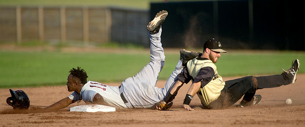 Joplin second baseman Mitch Glasser can't hold onto the ball as Kansas City's Vladimir Frias slides safely into second base during the Blasters' game against the T-Bones on Friday night at Joe Becker Stadium.<br /> Globe | Laurie Sisk