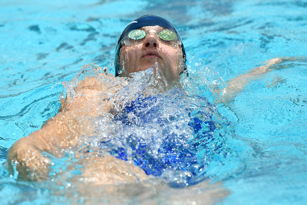 17-year-old Caitlin Mueller competes in the Womens 15 to 18-year-old 50y backstroke for the Joplin Stingrays during the Joplin Stingrays Invitational on Saturday at Schifferdecker Pool.<br /> Globe | Laurie Sisk