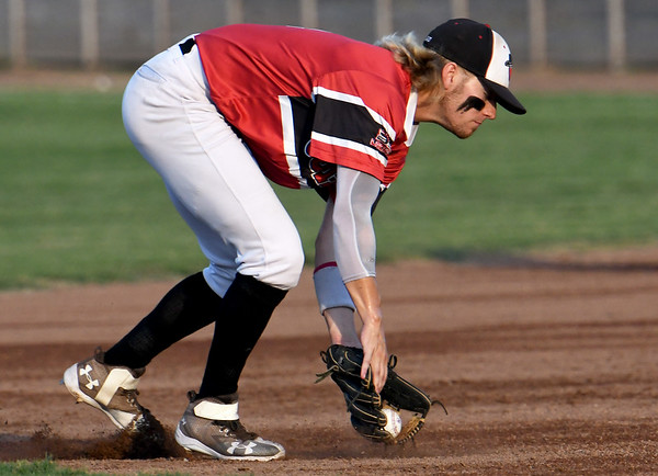 Joplin shortstop Jeff Wetzler fields a hard hit groundball during the Outlaws game against Nevada on Tuesday night at Joe Becker Stadium.<br /> Globe | Laurie Sisk