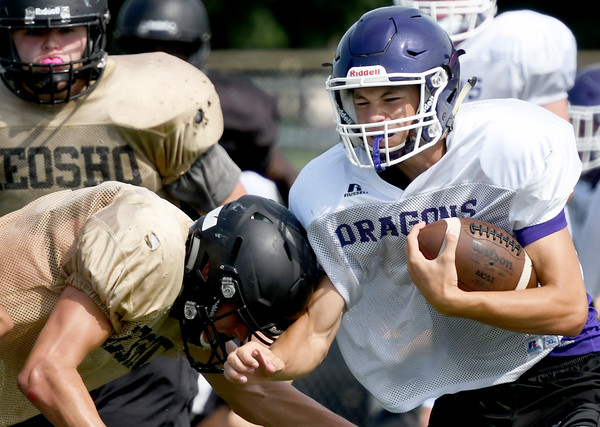 Pittsburg quarterback Chase Curtis absorbs a hit from a Neosho defender during a joint practice with PHS, Joplin and Neosho on Thursday at Pittsburg's Hutchinson Field.<br /> Globe   Laurie Sisk