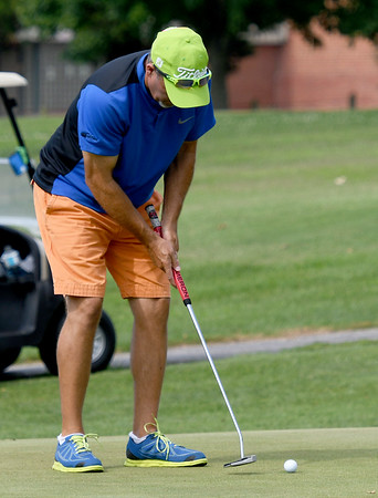 Scott Hartley, of Carthage, putts on the no. 4 green during the Ozark Amateur on Saturday at Schifferdecker Golf Course.<br /> Globe | Laurie Sisk