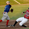 Joplin's Kaleb Delatorre gets caught on the front end of a double play as Nevada's Adam Eskil throws the runner out at first base during their game on Tuesday night at Joe Becker Stadium.<br /> Globe | Laurie Sisk