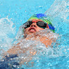 Eight-year-old Sayre Sundy swims the backstroke leg of the Boys 8 and under individual medley for the Joplin Stingrays during the Joplin Stingrays Invitational on Saturday at Schifferdecker Pool.<br /> Globe | Laurie Sisk