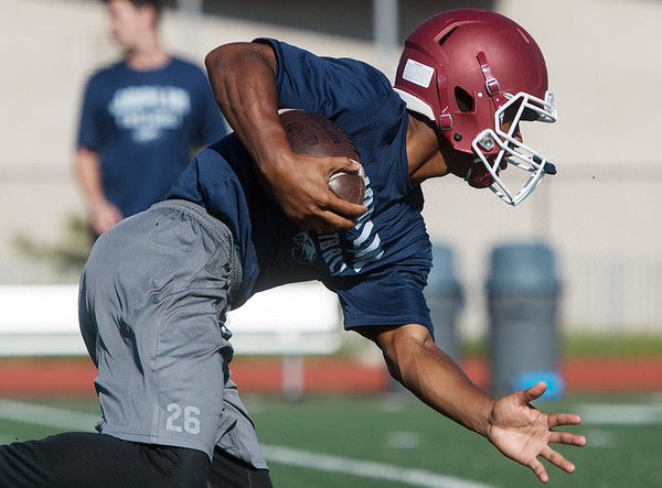 Globe/Roger Nomer<br /> Joplin's Jashawn Ellis, senior, runs through a drill on Monday at Joplin High School.
