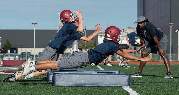 Globe/Roger Nomer<br /> Joplin High players run through a tackling drill on Monday at Joplin High School.