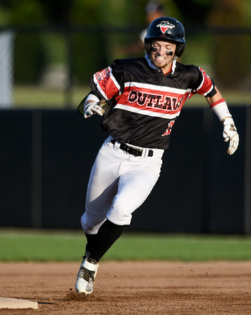 Outlaws shortstop Jeff Wetzler rounds second base enroute to a two-run triple during Joplin's game against Cassville on Tuesday night at Joe Becker Stadium.<br /> Globe | Laurie Sisk