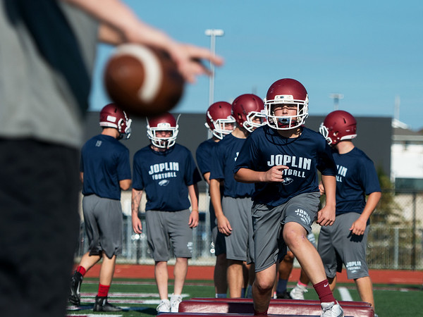 Globe/Roger Nomer<br /> Jacob Bartlett, senior, runs through a drill on Monday at Joplin High School.