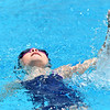 Eight-year-old Aislyn Downum swims the backstroke leg of the Girls 8 and under individual medley for the Joplin Stingrays during the Joplin Stingrays Invitational on Saturday at Schifferdecker Pool.<br /> Globe | Laurie Sisk