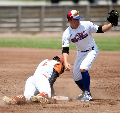 South Texas Sliders shortstop Jalen Battles slides safely into second base as Dallas Mustangs shortstop Turner Bannister fields the throw during their opening game in the 2017 Premier Baseball Junior Championship on Wednesday at Joe Becker Stadium.<br /> Globe | Laurie Sisk