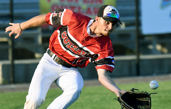 Joplin centerfielder Grant McDaniel catches up to a line drive during the Outlaws game against Nevada on Tuesday night at Joe Becker Stadium.<br /> Globe | Laurie Sisk
