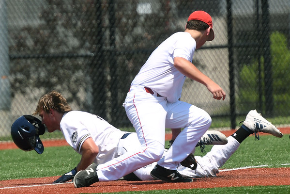UA Building Champions Laungamath's Kevin Charlton slides safely under the tag of Southwest Missouri All-Stars third baseman Carson Johnson during their opening game in the Premier Baseball Under 17 National Championship tournament on Wednesday at Joplin High School.<br /> Globe | Laurie Sisk