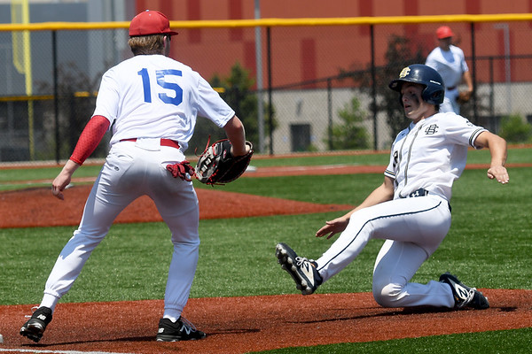 Southwest Missouri All-Stars first baseman Cale McCallister completes the back end of a double play after a non-tag on a pop-up as UA Building Champions Laungamath's Brett Bulkeley retreats back to first base during their opening game in the Premier Baseball Under 17 National Championship tournament on Wednesday at Joplin High School.<br /> Globe | Laurie Sisk