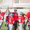 The Webb City little league players celebrate their big win Monday night against Daniel Boone little league in Joplin, Mo.