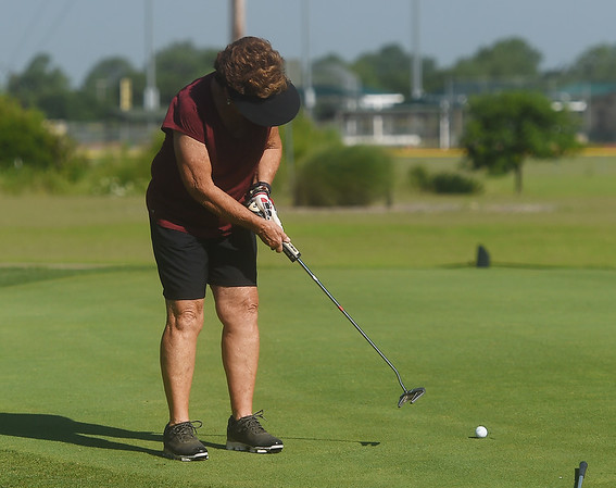 Sue Taylor putts during Monday's Horton Smith Cup at Schifferdecker Golf Course on Monday.<br /> Globe | Roger Nomer