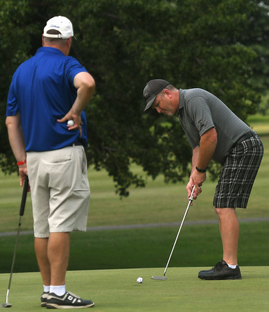 From the left: TJ Barry watches as Bill Chapin putts on the no. 9 green during the Ozark Amateur on Saturday at Schifferdecker Park.<br /> Globe | Laurie Sisk