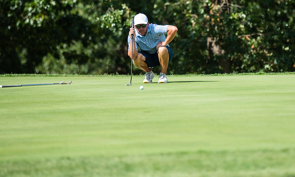 Jordan Burks lines his shot from the green during the final round of the Joplin Area Golf Championships at Briarbrook Golf Course in Carl Junction.<br /> Globe|Israel Perez