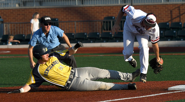 Jefferson City's XX (18) slides safely into third base as Outlaws third baseman John Prudhom fields the throw during their game on Tuesday night at Joe Becker Stadium.<br /> Globe | Laurie Sisk
