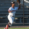 Outlaws leftfielder Mike Million handles a long fly ball during Joplin's Mink League play-off game against Jefferson City on Tuesday night at Joe Becker Stadium.<br /> Globe | Laurie Sisk