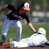 Southwest Missouri All-Star's Gage Kelley slides safely into second base as Rawlings Tigers Quatro's Tyler Gilmore applies the tag during their Premier Baseball Under 17 National Championship game on Saturday at Joplin High School.<br /> Globe | Laurie SIsk
