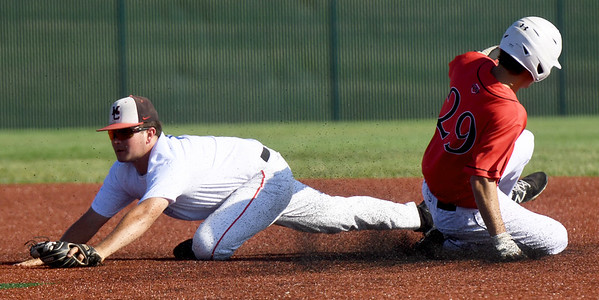 Southwest Missouri All-Stars second baseman Cole Martin stretches for the throw for the force out on Texas Stix's Will Miller (29) during their game in the Premier Baseball Under 17 National Championship tournament on Thursday at Wendell Redden Field.<br /> Globe   Laurie Sisk