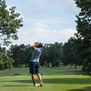 Jordan Burks tees off No. 16 as he keeps an eye on his shot  during the final round of the Joplin Area Golf Championships at Briarbrook Golf Course in Carl Junction.<br /> Globe Israel Perez