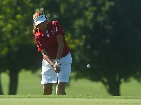 Carolyn Gilstrap chips onto the green during Monday's Horton Smith Cup at Schifferdecker Golf Course on Monday.<br /> Globe | Roger Nomer