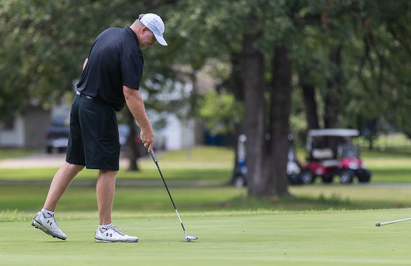 Billy Curry putts the green during the final round of the Joplin Area Golf Championships at Briarbrook Golf Course in Carl Junction.<br /> Globe|Israel Perez