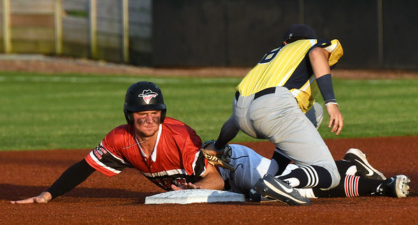 Joplin's John Prudhom slides safely into second base as Jefferson City's xx (8) applies the tag during their game on Wednesday night at Joe Becker Stadium.<br /> Globe | Laurie Sisk