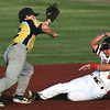 Outlaws lead off hitter Zack Ehlen (2) slides safely into second base as Jefferson City's XX (12) gloves the throw during their game on Tuesday night at Joe Becker Stadium.<br /> Globe | Laurie Sisk