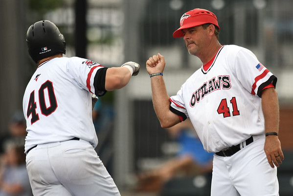 Outlaws manager Danny Weaver congratulates Donovan Sutti (40) after Sutti put the Outlaws ahead early with a three-run homerun during the first game of a doubleheader against Nevada on Saturday at Joe Becker Stadium.<br /> Globe   Laurie Sisk