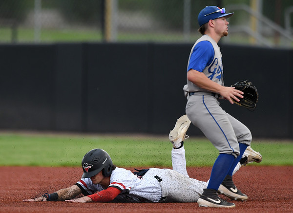 Outlaws infielder Jack Hanstad slides well ahead of the throw for the first of two consecutive stolen bases as Nevada's Eli Harrison awaits the throw during the first game of a doubleheader on Saturday at Joe Becker Stadium.<br /> Globe   Laurie Sisk