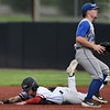 Outlaws infielder Jack Hanstad slides well ahead of the throw for the first of two consecutive stolen bases as Nevada's Eli Harrison awaits the throw during the first game of a doubleheader on Saturday at Joe Becker Stadium.<br /> Globe | Laurie Sisk