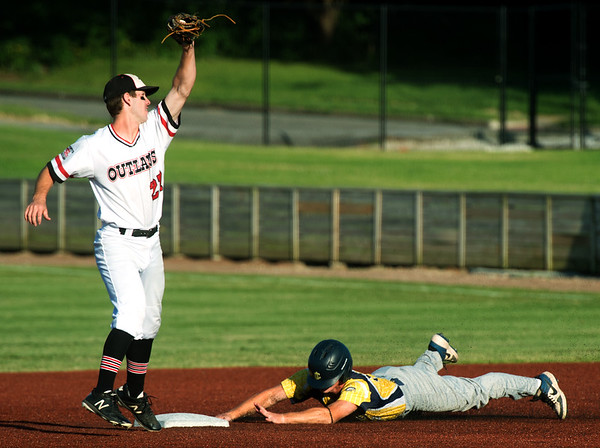 Joplin's David Butterfield stretches for the throw as Jefferson City's Peyton Leeper (12) slides safely into second base during their Mink League play-off game on Tuesday night at Joe Becker Stadium.<br /> Globe | Laurie Sisk