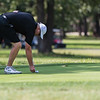Billy Curry places his ball on the green during the final round of the Joplin Area Golf Championships at Briarbrook Golf Course in Carl Junction.<br /> Globe Israel Perez