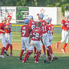 Webb City little league players celebrate their big win on Monday night against Daniel Boone little league in Joplin, Mo.