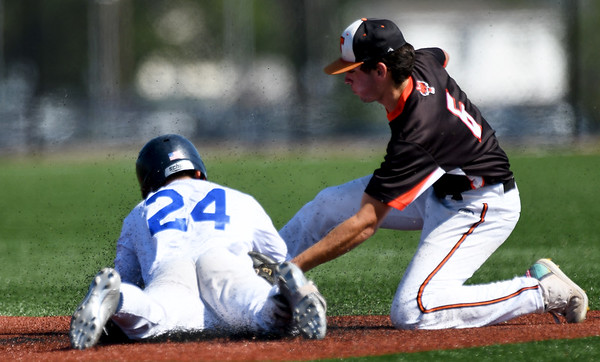 Southwest Missouri All-Star's Holden Ledford is tagged out by Rawlings Tigers Quatro's Tyler Gilmore during their Premier Baseball Under 17 National Championship game on Saturday at Joplin High School.<br /> Globe | Laurie SIsk