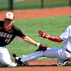 Southwest Missouri All-Star's Cale McAllister slides safely into third base as Rawlings Tigers Quatro's Ethan Abercrombie applies the tag during their Premier Baseball Under 17 National Championship game on Saturday at Joplin High School.<br /> Globe | Laurie SIsk