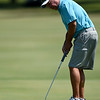 Defending champion Lowell Catron watches his putt roll toward the cup on the no. 2 green during the Joplin Area Golf Championship on Saturday at Schifferdecker Golf Course.<br /> Globe   Laurie Sisk