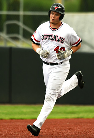 Outlaws slugger Donovan Sutti rounds the bases after putting the Outlaws ahead early with a three-run homerun during the first game of a doubleheader against Nevada on Saturday at Joe Becker Stadium.<br /> Globe | Laurie Sisk