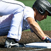 Southwest Missouri All-Stars' Monty Mailes slides safely into third base as Stix-Mistler's Colton Craddock mans the throw during their game in the Premier Baseball Under 17 National Championship tournament on Friday at Warren Turner Field.<br /> Globe | Laurie Sisk