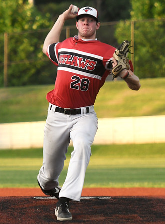 Outlaws starter Chase Plymell delivers a pitch to the plate during Joplin's game against the Jefferson City Renegades on Wednesday night at Joe Becker Stadium.<br /> Globe | Laurie Sisk