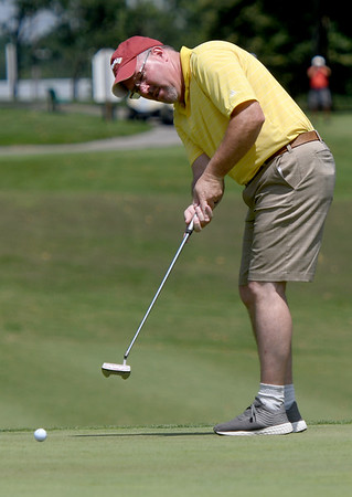 Stefan Smith TJ Barry watches his ball roll toward the cup on the no. 9 green during the Ozark Amateur on Saturday at Schifferdecker Park.<br /> Globe | Laurie Sisk