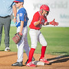 Webb City's Luke Beverlin celebrates his single and his rbi to bring in the tying run in Monday nights game against Daniel Boone Little League in Joplin, Mo. (Daniel Boone player pictured : #21  Matthew States)
