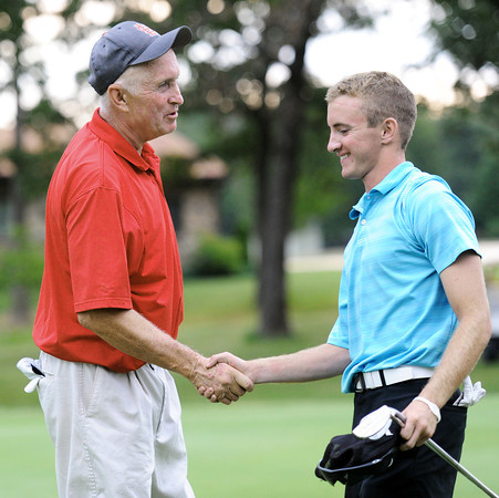 Globe/T. Rob Brown<br /> The two final contestants shake hands following sudden death playoff portion of Sunday's championship flight at Briarbrook Golf Course & Country Club in Carl Junction.