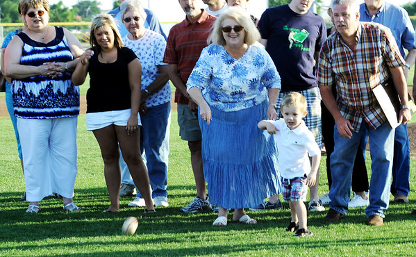Globe/T. Rob Brown<br /> Great-grandson of the late Wendell Redden, supported by family members, throws out the first pitch Tuesday evening, June 5, 2012, at the newly-named Wendell Redden Field in the Joplin Athletic Complex.