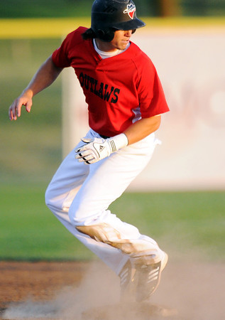 Globe/T. Rob Brown<br /> Joplin Outlaws runner Patrick Dake turns to see where the batter's ball flew, while taking second base against St. Joseph Tuesday evening, June 5, 2012, at the newly-named Wendell Redden Field in the Joplin Athletic Complex.