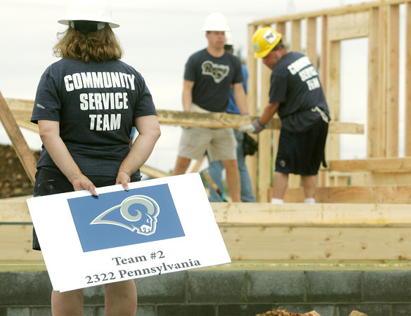 Globe/Roger Nomer<br /> Staff and rookie players from the St. Louis Rams visit Joplin on Thursday afternoon to help with three Habitat for Humanity projects.